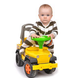 Infant child baby boy toddler happy driving big toy car truck Stock Photo