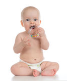 Infant child baby boy toddler playing and eating with circle rin Royalty Free Stock Images