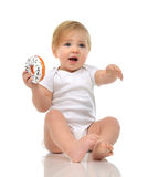 Infant child baby boy toddler playing on a floor on and looking Stock Photos