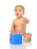 Infant child baby boy toddler playing holding blue bricks toy in Royalty Free Stock Images