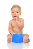 Infant child baby boy toddler playing holding blue bricks toy in Stock Photography