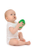 Infant child baby boy toddler playing holding green circle in ha Royalty Free Stock Photos