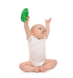 Infant child baby boy toddler playing holding green circle in ha Royalty Free Stock Images
