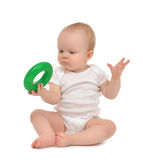 Infant child baby boy toddler playing holding green circle Stock Image