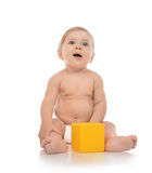 Infant child baby boy toddler playing holding yellow brick toy i Stock Photography