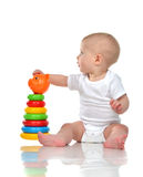 Infant child baby boy toddler playing with Pyramid in hand Stock Image