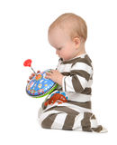 Infant child baby boy toddler playing with whirligig toy Stock Photo