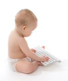 Infant child baby boy toddler typing computer keyboard Stock Image