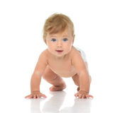 Infant child baby girl in diaper crawling happy looking at the c Stock Photo