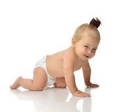 Infant child baby girl in diaper crawling happy smiling looking Royalty Free Stock Images