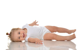 Infant child baby girl in diaper lying on a back happy smiling Stock Image