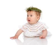 Infant child baby girl in diaper lying happy in circlet of flowe Stock Images