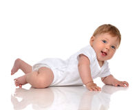Infant child baby girl in diaper lying happy smiling looking at Royalty Free Stock Image