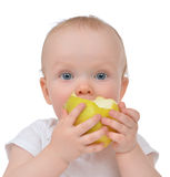 Infant child baby girl eating apple closeup Royalty Free Stock Photo