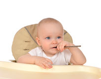 Infant child baby girl eating spoon Royalty Free Stock Photos