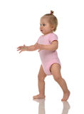 Infant child baby girl kid toddler in pink body cloth make first Stock Photography
