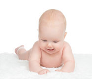 Infant child baby girl lying happy on blanket and playing Royalty Free Stock Photo
