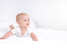 Infant child baby girl lying happy smiling on blanket. Infant child baby boy lying happy smiling on white blanket. Cute newborn on white light background Stock Photography