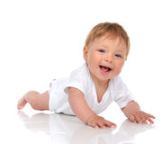 Infant child baby girl in lying happy smiling laughing Stock Photography