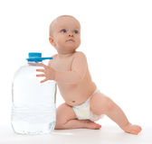 Infant child baby girl sitting with big bottle of drinking water Royalty Free Stock Images