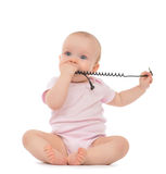 Infant child baby girl sitting with  power charger Stock Photos