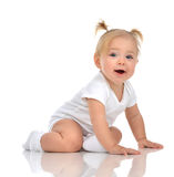 Infant child baby girl toddler crawling happy looking straight. Isolated on a white background royalty free stock images