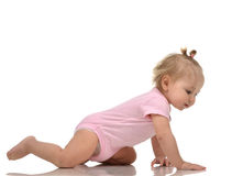 Infant child baby girl toddler crawling happy looking straight Royalty Free Stock Image
