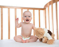 Infant child baby girl toddler shouting in diaper with teddy bea Royalty Free Stock Images