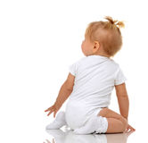 Infant child baby girl toddler sitting backwards back view looki Stock Photos