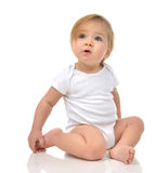 Infant child baby girl toddler sitting in body  with text space. And happy looking at the corner isolated on a white background Stock Photography
