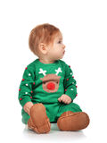Infant child baby girl toddler sitting looking at the corner Stock Photo