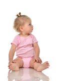Infant child baby girl toddler sitting and looking up Stock Photo