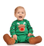 Infant child baby girl toddler sitting smiling laughing in green Royalty Free Stock Images