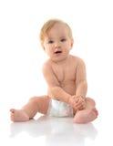 Infant child baby girl toddler sitting thinking Stock Photos