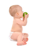 Infant child baby infant girl eating apple closeup Stock Photo