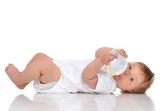 Infant child baby kid lying and drinking water from the feeding Royalty Free Stock Image