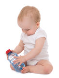 Infant child baby sitting with bottle of drinking water Stock Photography