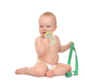 Infant child baby tape measure measuring body drinking from feed Stock Photos