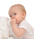 Infant child baby toddler closeup portrait eating soft blanket Royalty Free Stock Photo