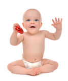 Infant child baby toddler holding red heart valentines Stock Image