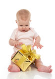 Infant child baby toddler kid with gold present gift for birthda Royalty Free Stock Images