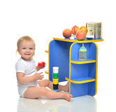 Infant child baby toddler kid happy sitting and playing with col Stock Photos