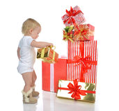 Infant child baby toddler kid preparing presents gifts Royalty Free Stock Photo