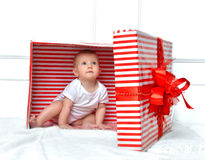 Infant child baby toddler kid sitting in presents gift for celeb Royalty Free Stock Photo