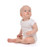 Infant child baby toddler sitting or crawling Stock Image