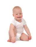 Infant child baby toddler sitting or crawling happy smiling Stock Photo