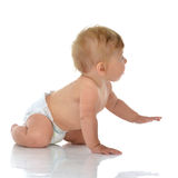 Infant child baby toddler sitting or crawling looking at the cor Stock Photography