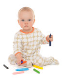Infant child baby toddler sitting drawing painting with color pe. Ncils crayons on a white background stock photography