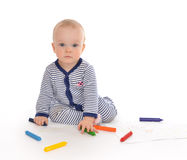Infant child baby toddler sitting drawing painting with color pe Stock Image