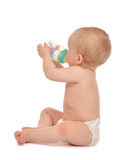 Infant child baby toddler sitting and drinking water from the fe Royalty Free Stock Images